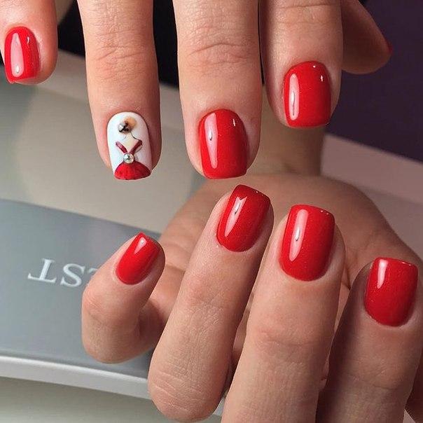 Шикарный и очень яркий дизайн для оформления ногтей. Кровавый алый оттенок отлично гармонирует с безымянным пальцем, основа которого выполнена в белом цвете.