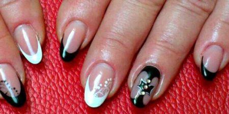 Черно - белый френч на овальной форме ногтя с дизайном